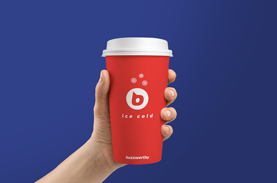 hand holding a buzzworthy branded paper cup