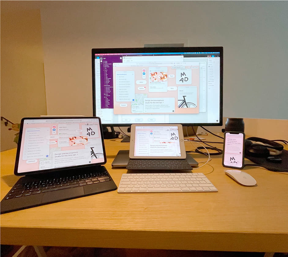 Desktop with different elements: computer, tablet and mobile phone showing the design in their screens